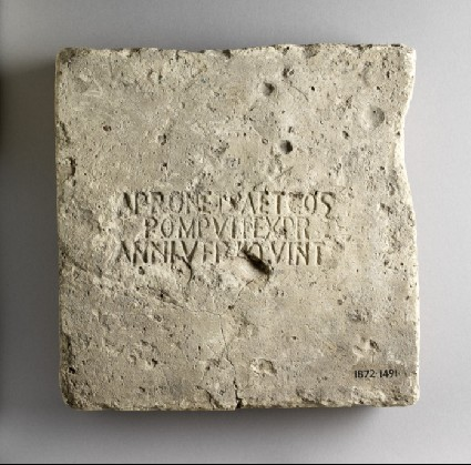 Brick stamped with Latin script