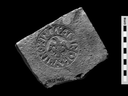 Brick stamp with Latin script, eagle in the centre