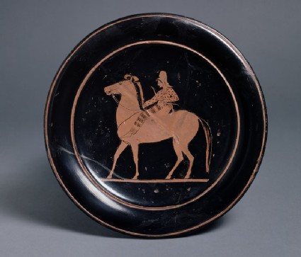 Attic red-figure pottery plate depicting a mounted archer