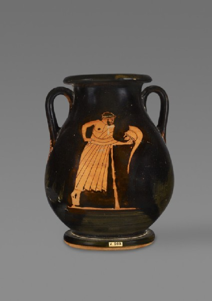 Attic red-figure pottery pelike depicting an elderly male figure and a bearded satyr