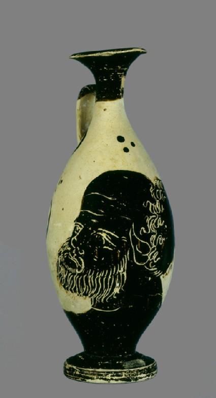 Black-figure pottery lekythos (oil-jar) with the head of Silenus