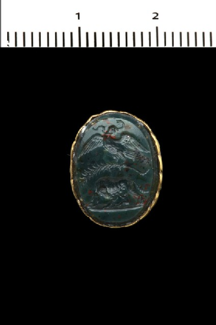 Intaglio gem, an eagle devours a serpent and holds a palm of victory over the Roman wolf, who suckles Romulus and Remus