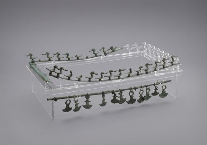 Rim of bronze tray, decorated with bronze ducks riveted to the rim