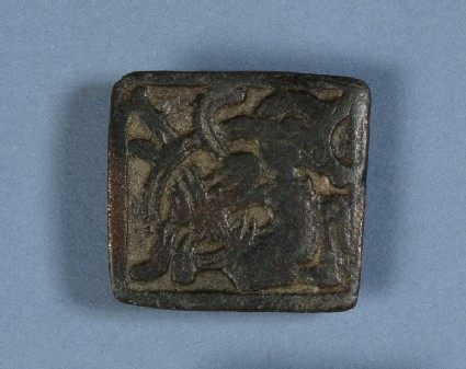 Square-headed brooch with animal decoration in relief