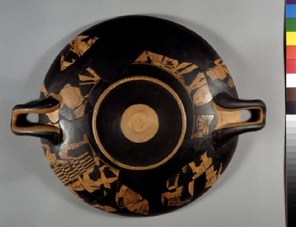 Attic red-figure stemmed pottery cup depicting a battle scene