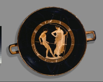 Attic red-figure stemmed pottery cup depicting an athletics scene