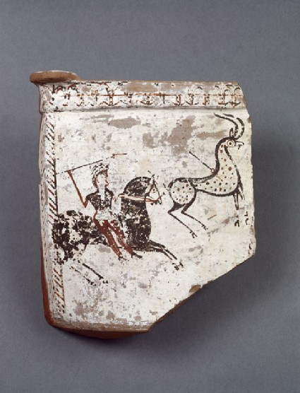 Funerary urn fragment decorated with hunter on a horse with a raised arrow