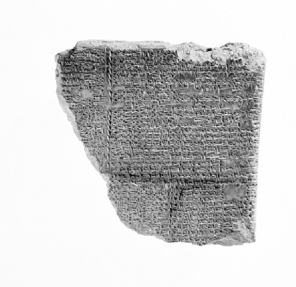 Clay tablet with inscribed cuneiform text concerning astrological omens