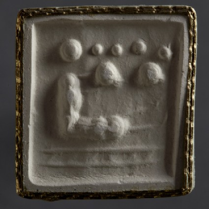 Cylinder seal depicting woman with outstretched legs on mat