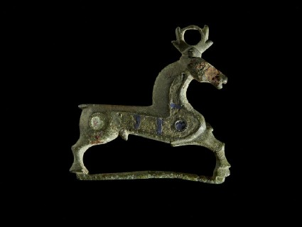 Enamelled bronze brooch in the form of a stag