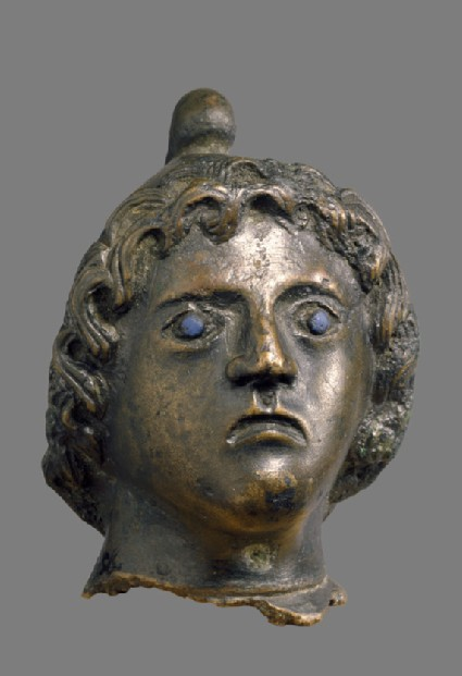 Bronze head with Phrygian cap and inlaid blue glass eyes, possibly Atys