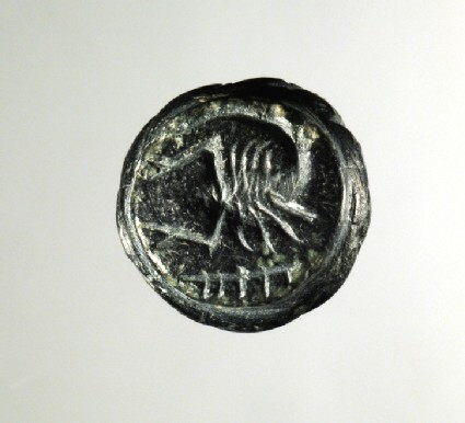 Pear- or bottle-shaped, black steatite loop signet (Petschafte) seal: on the face of the signet a scorpion