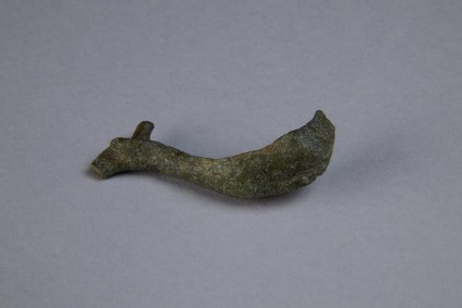 Bronze fibula in the shape of a dolphin