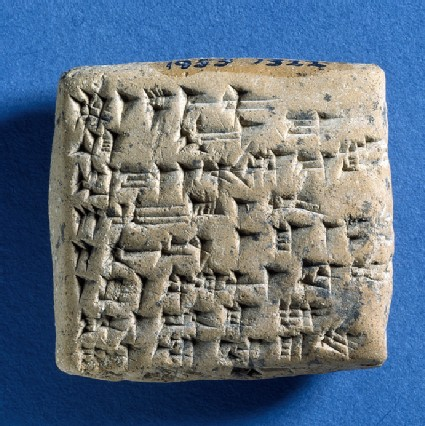 Inscribed cuneiform clay tablet with seal impression with hero scene