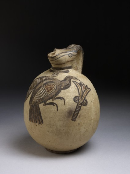 Squat bichrome jug in free-field style with image of bird picking a lotus flower