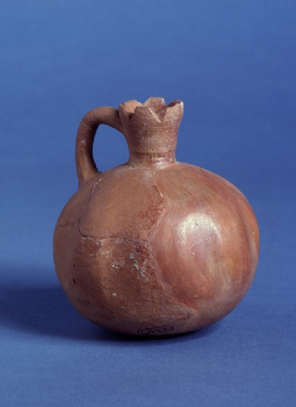 Fine burnished juglet in shape of a pomegranate