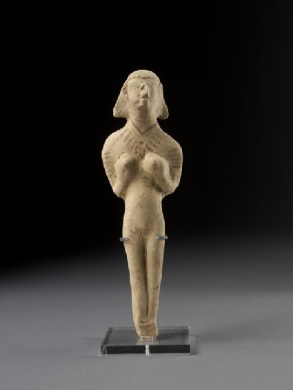 Naked female, possibly a goddess, holding her breasts (Astarte figurine)