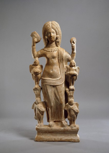 Terracotta statuette of Venus, or a young woman dressed at Venus, at her toilet