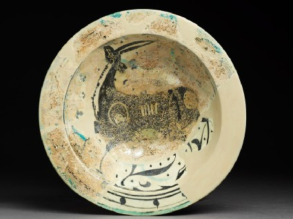 Bowl with deer, flowers, and dots