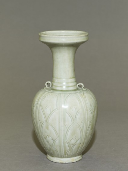 Greenware vase with floral decoration