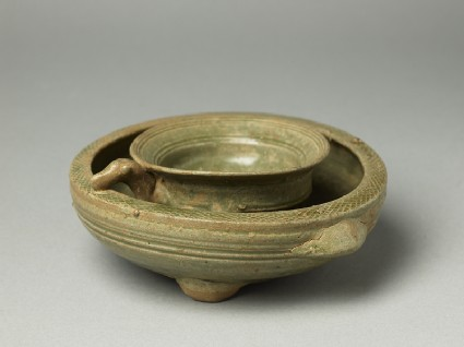 Greenware tripod vessel with inner bowl