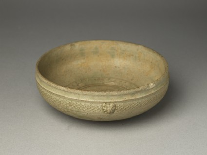 Greenware bowl with animal masks