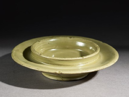 Greenware cup stand with foliated rim