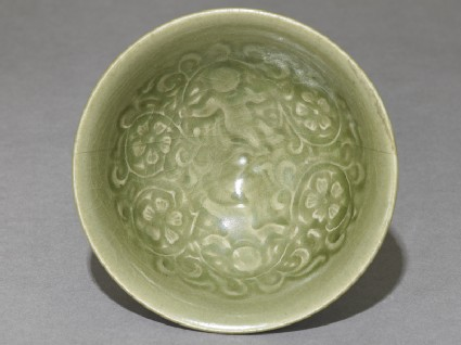 Greenware bowl with boys amid peony scrolls