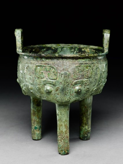 Ritual food vessel, or ding, with dragon and taotie masks