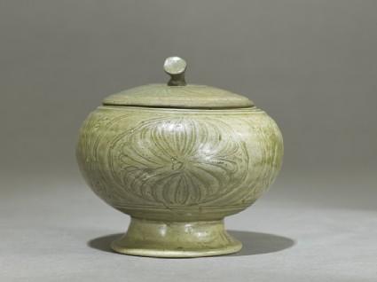 Globular greenware jar with lotus flower decoration