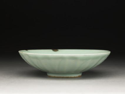 Greenware dish with fluting, and lotus petals on the outside