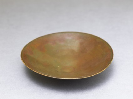 Ding type bowl with russet iron glaze