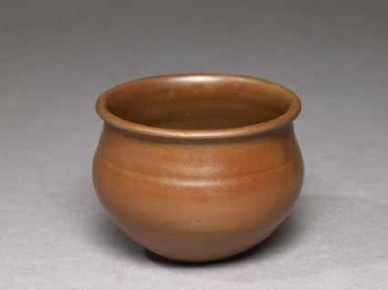 Ding type jar with russet iron glaze