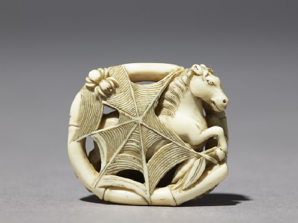 Netsuke depicting a horse caught in a spider's web