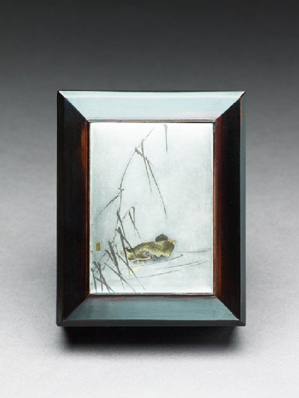 Box with plaque depicting a duck swimming past reeds