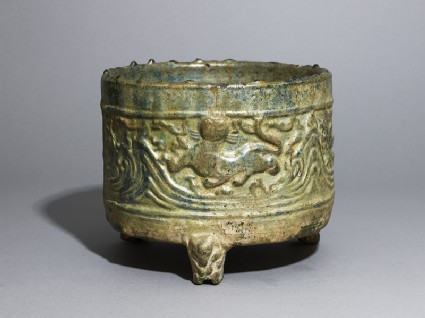 Three-legged basin, or lian, with tigers and mountains in relief