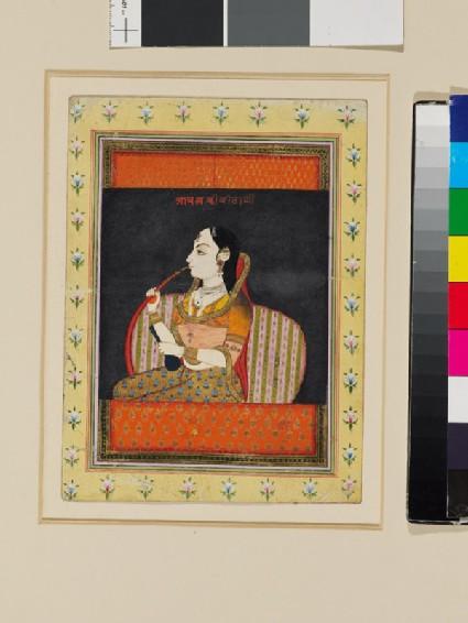 Bust of a woman in a jharoka window