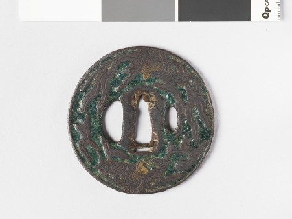 Round tsuba with design of phoenix and paulownia leaves