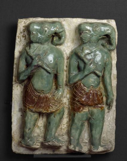 Plaque with elephant-headed warriors