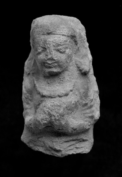 Female figure with folded hands, possibly a plaque