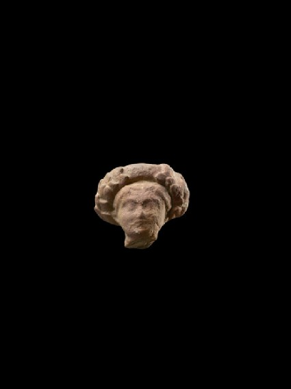 Head of a figure with wreath, possibly female