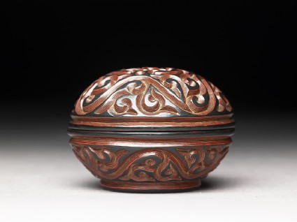 Lacquer box with scroll and floral decoration
