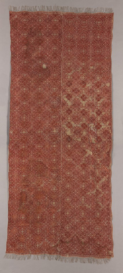 Coverlet with diamond-shapes containing medallions and protruding hooks