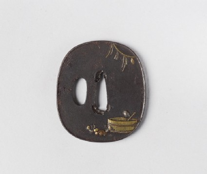 Round tsuba with design of a bird on a water tub