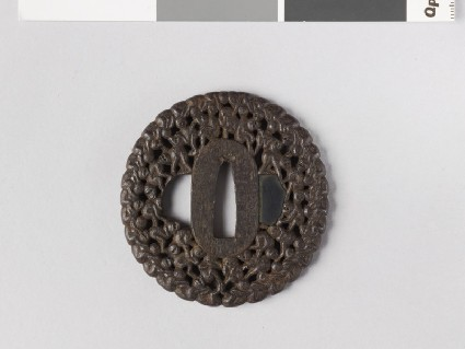 Round tsuba with design of The Hundred Monkeys