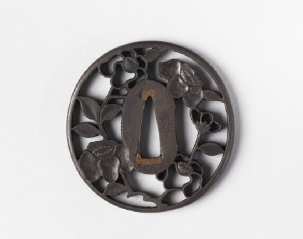 Round tsuba with design of camellia flowers and leaves