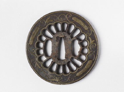 Round tsuba with design of rope, feathers and tendrils