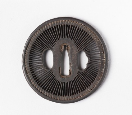 Round tsuba with design of amida-yasurime (radial striations)
