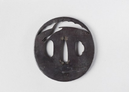 Round tsuba with design of a goose flying over water