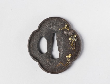 Mokkō-shaped tsuba with design of gourd vines, a frog and amida-yasurime (radial striations)